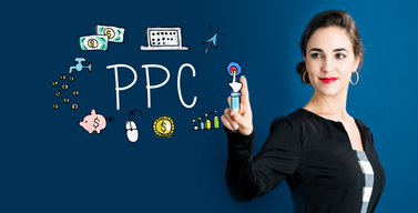 Business woman pointing at an image of a click with other graphics depicting the components of pay per click advertising